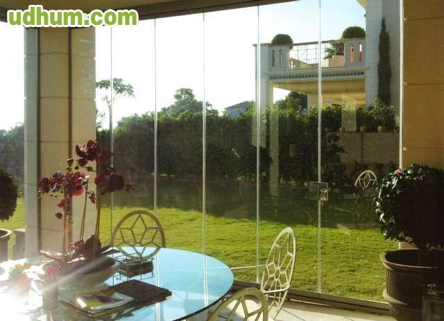 Cortina de cristal aluminio y pvc - Vidrios para terrazas ...