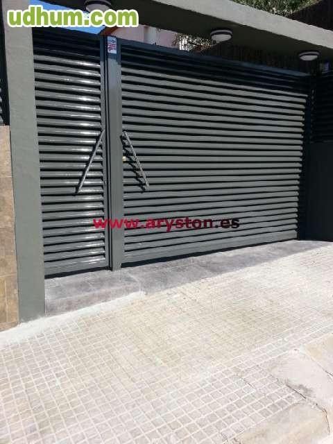 Puerta garaje puerta basculante for Puerta garaje basculante precio